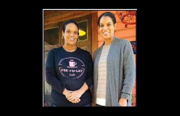 Twin sisters Jo and Joy Banner invite you to stop by Fee-Fo-Lay Café, located on the River Road in Wallace (about 1/4 of a mile from the Veterans Memorial Bridge) for a delicious cup of coffee, a plate of fresh beignets and a look into their family's h