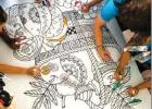 Louisiana FCU employees create a vibrant 4' x 5' coloring board to be displayed at Children's Hospital.